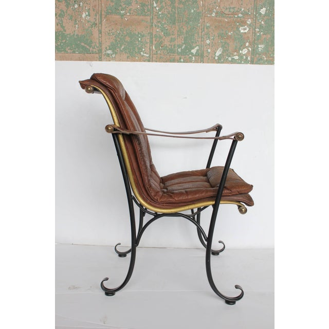 Rare 1940s leather and iron armchair by Lee Woodard. Original leather upholstery.