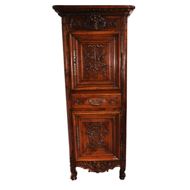 Elegantly carved antique Homme Debout from Southern France, circa 1840. The fruitwood cabinet features two single doors...