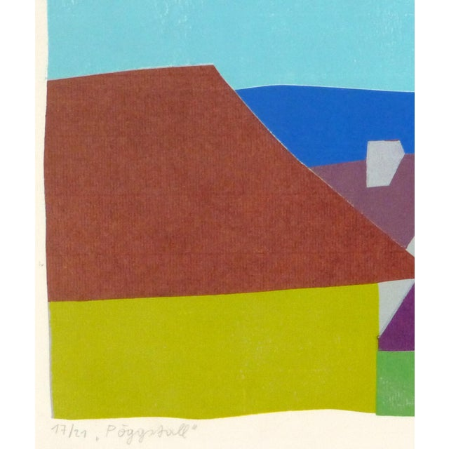 "Bright fine art lithograph of colorful rooftops backed by a mountain landscape, titled ""Pöggstall,"" a small town in..."