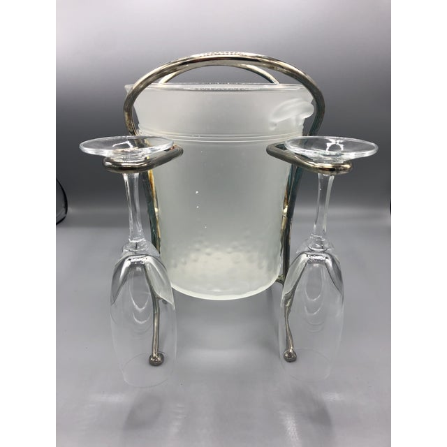 Mid-Century glass & chrome caddy Ice bucket with 4 champagne glasses. Great for your next party/event. In good condition...