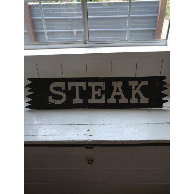 I love this fun sign originally from a western themed steak restaurant. A bit weathered as it hung outside for many years....