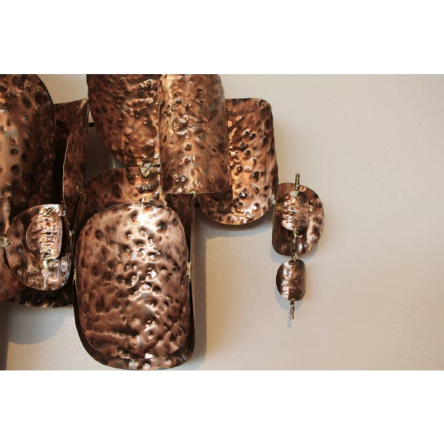 A pair of Brutalist wall sculptures in the manner of Silas Seandel, Curtis Jere or even Thom Greene. They look hand...