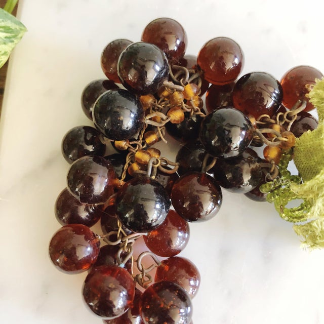 Vintage French cluster of purple glass grapes with wire and amber beaded stems and velvet fabric leaves.