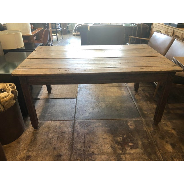 Feast your eyes on this gorgeous and rustic early 20th century French farmhouse table. Years of love and wear have brought...
