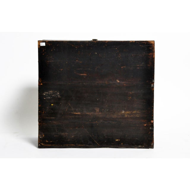 This softwood storage trunk has highly stylized decorative white pewter fittings, and was used to hold blankets, garments...