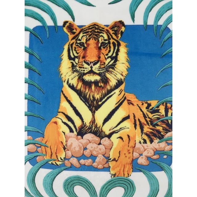 Sueded cotton pillow cover with image of a tiger surrounded by palm leaves. Cover has gold fringe trim and has the same...