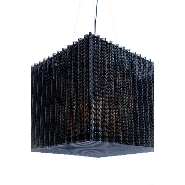 An accordian ribbed, metal mesh, cube shape cage, holding a 4-light, crystal beaded basket. Bayonet sockets with beaded...