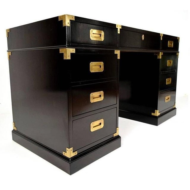 Fine quality desk. It includes seven drawers, a central drawer with a pencil/pen ledge inside between the pedestals and...