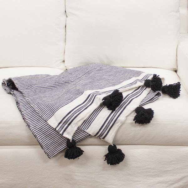 We source these throws from Morocco. They are hand loomed with cotton sheared from the sheep that roam the hillsides. This...