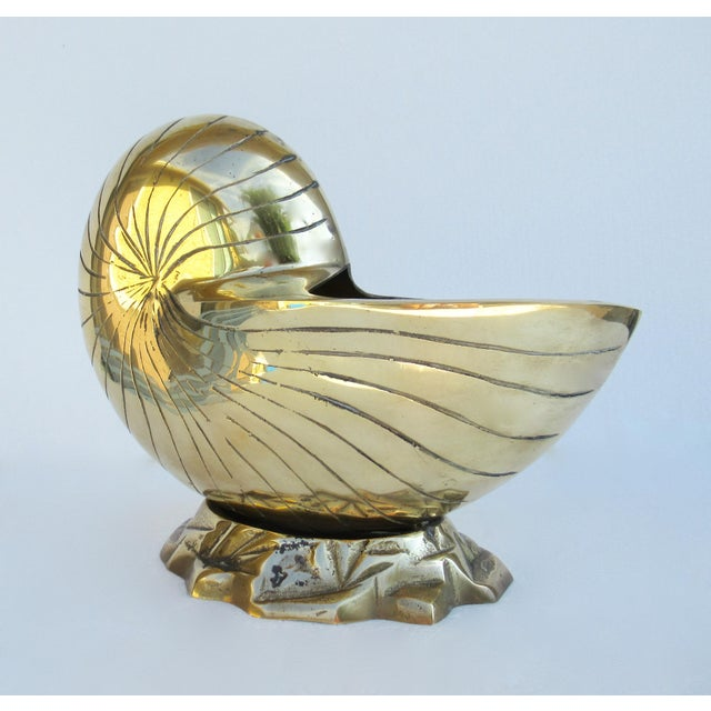 C.1960s; Mid-Century brass nautilus planter, hand forged, onto a brutalist styled, wave-like visual, indicative to...