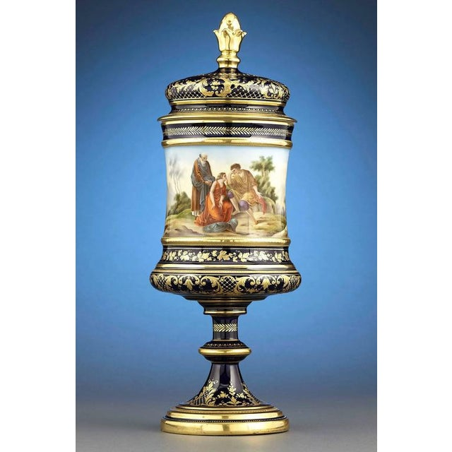 A beautiful Royal Vienna Porcelain urn showcasing the firms renowned rich, cobalt blue background contrasted by lush gilt...