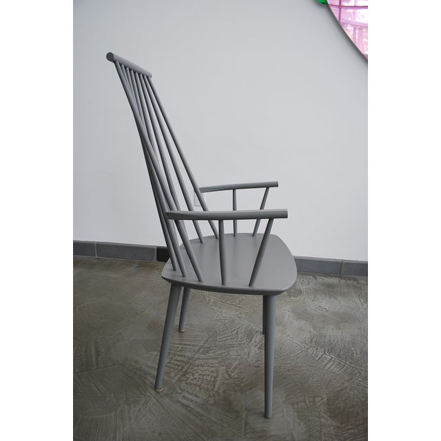 A J110 dining chair that is part of HAY's 2011 relaunch of the Danish furniture classics originally made for FDB (The...