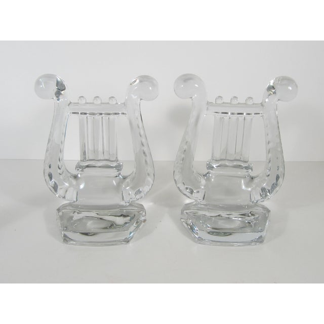Great set of Fostoria Glass bookends in the shape of musical lyres. One still has the original Fostoria label on it.