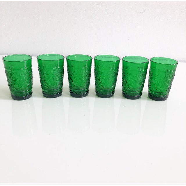 Fun vintage 1960s kelly green small juice glasses. Great green color with three dimensional design on the outside of the...