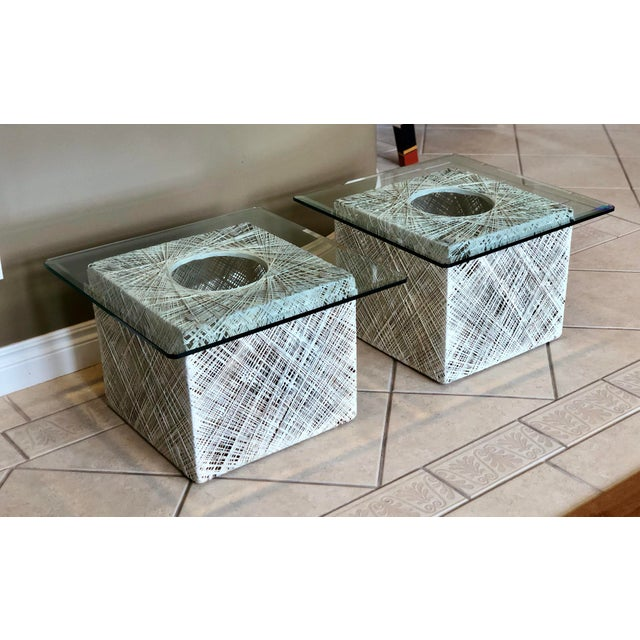 We are pleased to offer a pair of fabulous, modern Russell Woodard spun fiberglass square side tables, circa the 1970s....