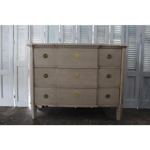 Gorgeous vintage Swedish commode with three spacious drawers. Resting on tapered block legs with vertical cuts, this piece...