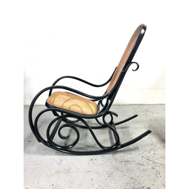 A classic and comfortable chair based on Thonet design and made in Italy circa 1960s. Black finish nicely complements...