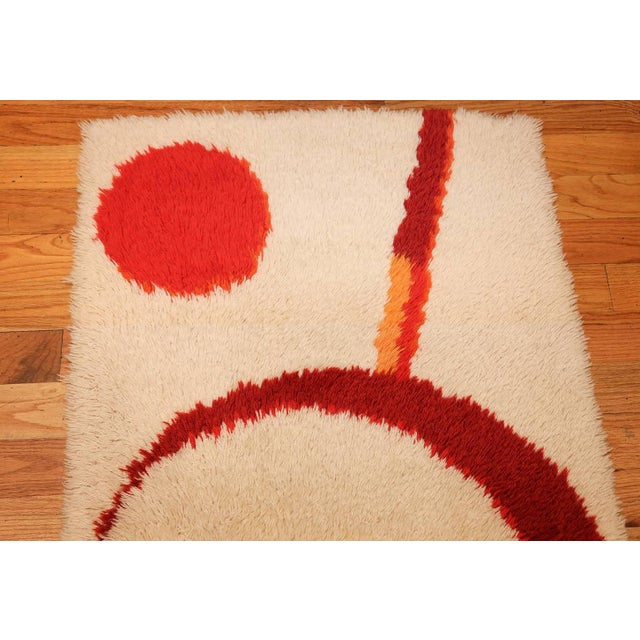 This celestial vintage Swedish deco rug features a fabulous pattern of interlocked warm-tone crescents paired with...