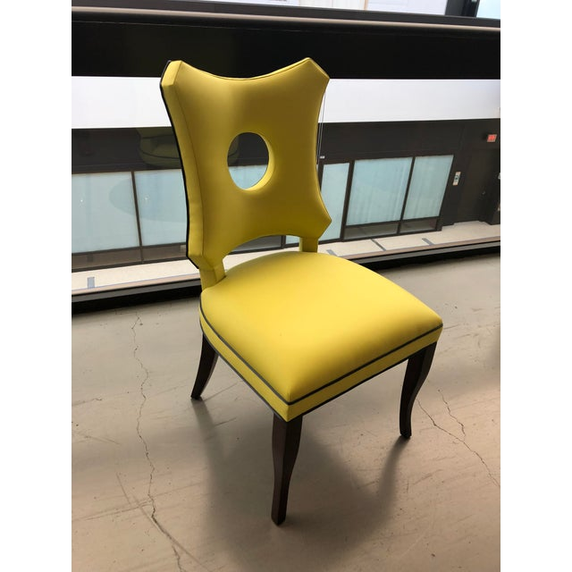 Los Angeles floor sample Duncan side chair. This can be used as a dining chair, a desk chair or accent chair. It is...