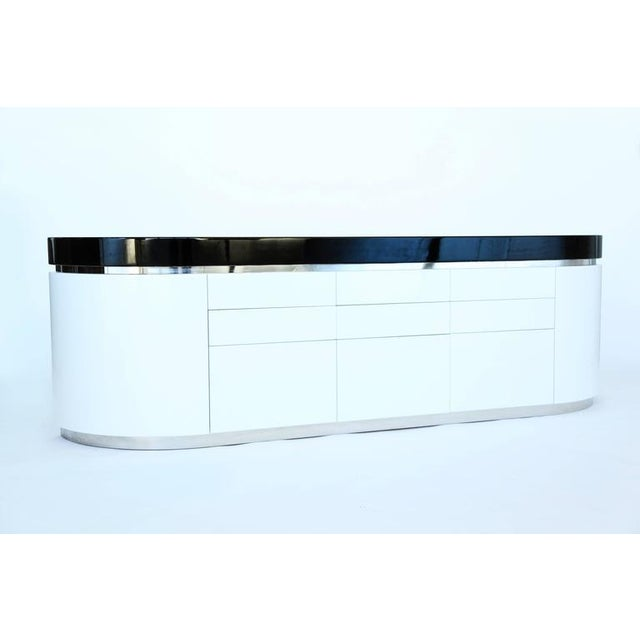 "J. WADE BEAM ""Ponte"" Cabinet Modernist curvilinear cabinet in black and white lacquer with a chrome-clad steel reveal;..."