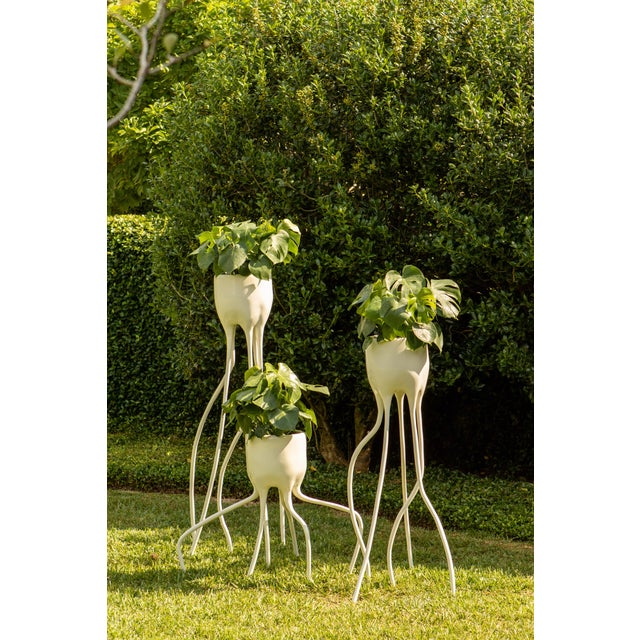 Porcelain planters, hand sculpted in the Netherlands. Available in three different sizes and colors. Priced each.