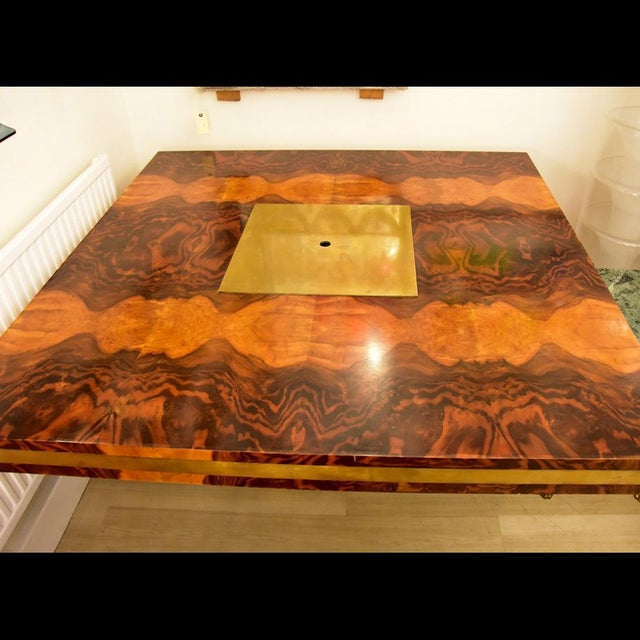 An outstanding 1970s dining table, wood laminate with brass detail. Design by Willy Rizzo MEASUREMENTS Height: 74cm Depth:...