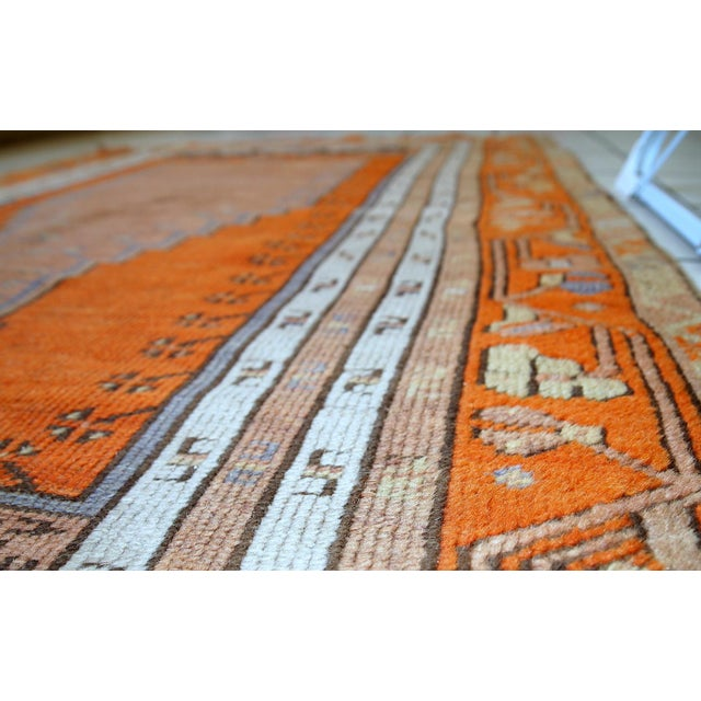Antique Turkish Anatolian rug in original condition. This rug is prayer and made in bright orange shade with accents of...