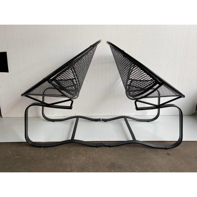 Very stylish pair of John Salterini matching bouncer chairs in black