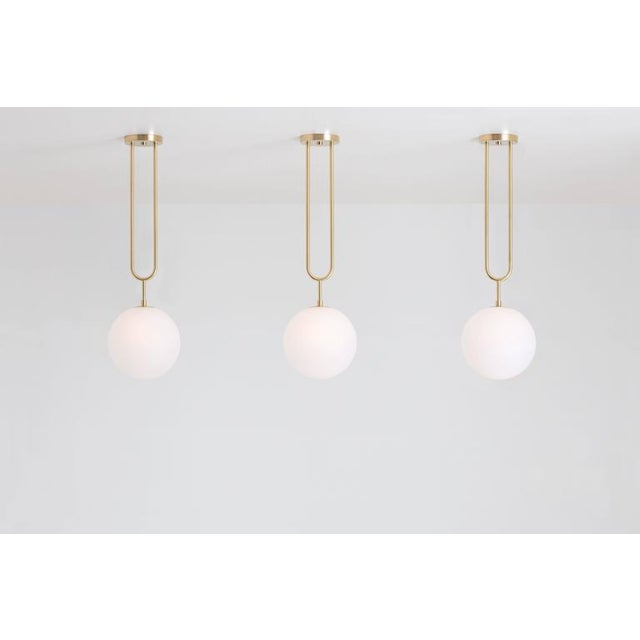 Drawing inspiration from a pearl pendant, the Koko line is elegant and modern, with its luminous blown glass and brass...