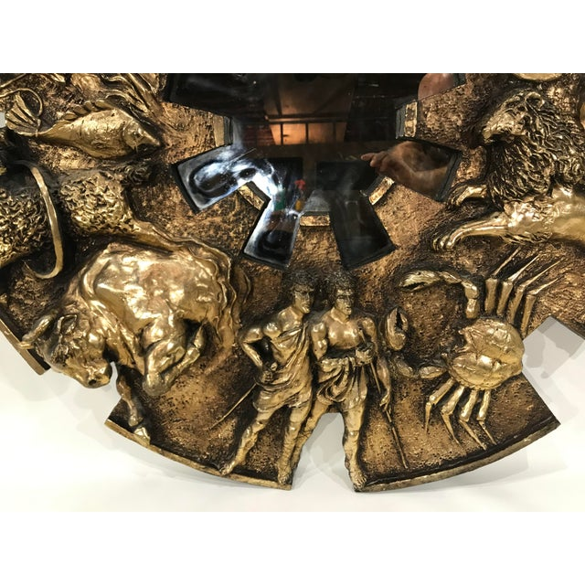 This large Brutalist Zodiac Wall Mirror by Finesse Originals is in wonderful condition and is the perfect focal point to...