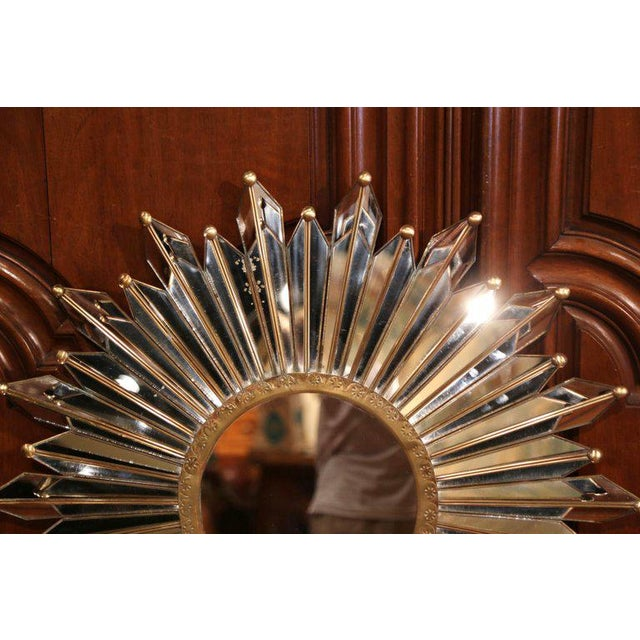 This beautiful, vintage sun mirror was crafted in Paris, France, circa 1920. The large, elegant wall hanging mirror...