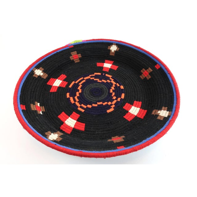 Moroccan Berber wool and straw basket traditionally used to hold and transport bread (khobz), these graphic pieces can be...