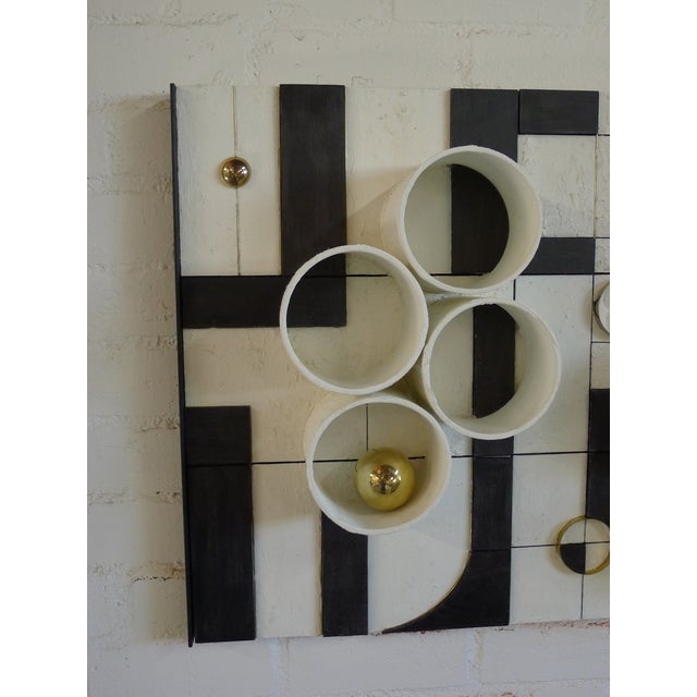 Modern frieze three-dimensional wall art by Paul Marra. Wood, brass, nickel, paper and paint. Coloration will vary with...