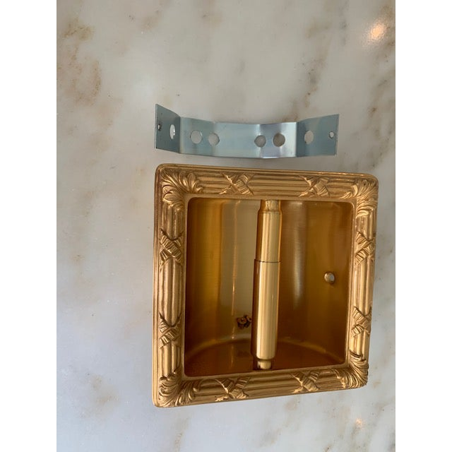 Gold plate Sherle Wagner Reed and Ribbon recessed paper towel holder. Excellent condition with minor scratches inside.