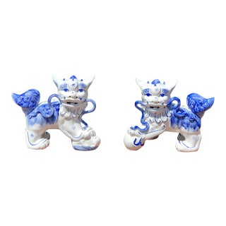 Vintage Chinoiserie Style Blue and White Foo Dogs- a Pair For Sale
