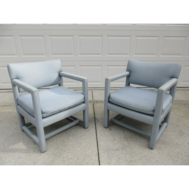 These light blue and white parsons style chairs are by Ethan Allen. The seats are firm and the chairs are in very good...