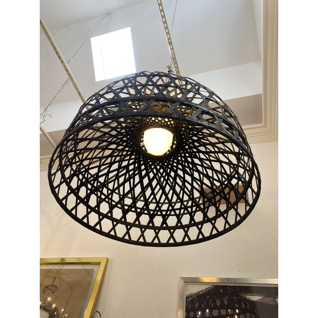 This bamboo fixture is fashioned after a nightingales cage. The rattan-style shade is crafted from hand woven bamboo.
