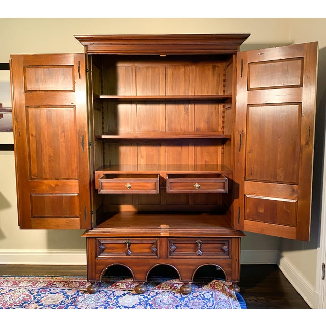 The finest handmade craftsmanship in this gorgeous carved armoire by Alfonso Marina. The armoire has brass pulls with...
