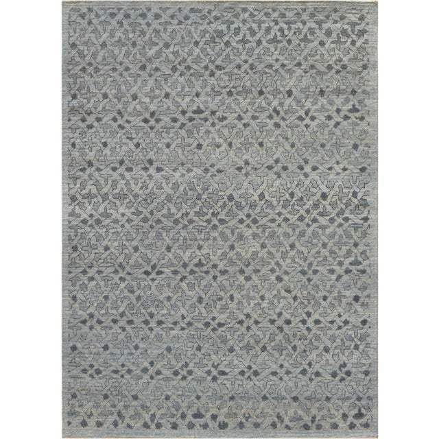 Genuine quality handwoven modern rug from Kashmir. This unique rug features an amazing unique design and color scheme. It...