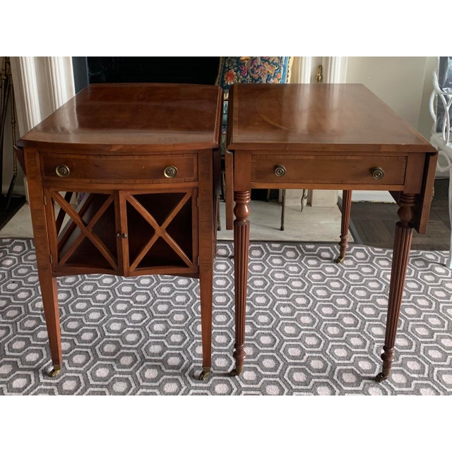 Pair of 1940s drop leaf side tables by Dell'Aira & Stea, New York. Table vary slightly in style, used on either side of a...