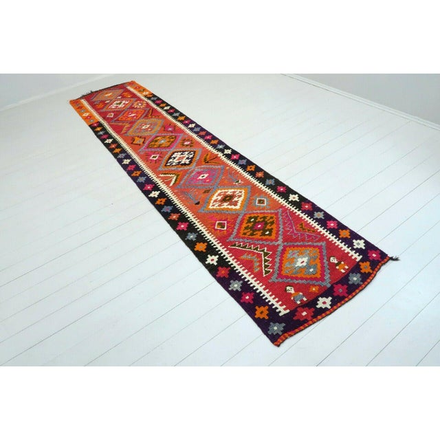 This beautiful, vintage, handwoven kilim is approximately 60 years old. It is handmade of very fine quality wool and...