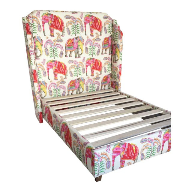Absolutely stunning, one of a kind custom platform bed clad in Clarence House's colorful Batyr elephant print fabric....