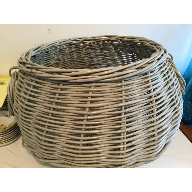 Large decorative basket with handles. Use for storage or as a decorative piece.