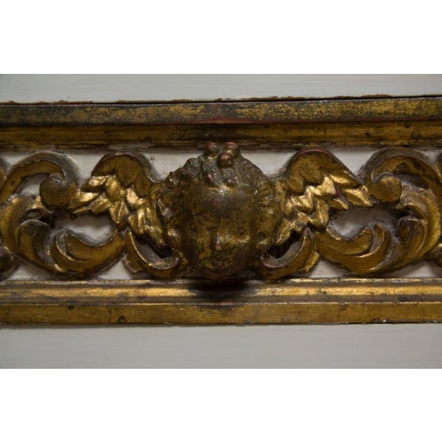 This lovely pair of Italian white painted and parcel-gilt three-drawer chests have drawer faces heavily carved with a...