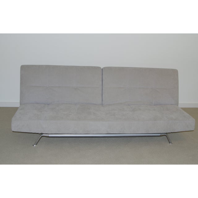 Classic modern Ligne Roset Smala sofa. Covered in custom light grey suede. Excellent condition. Back and armrests may be...