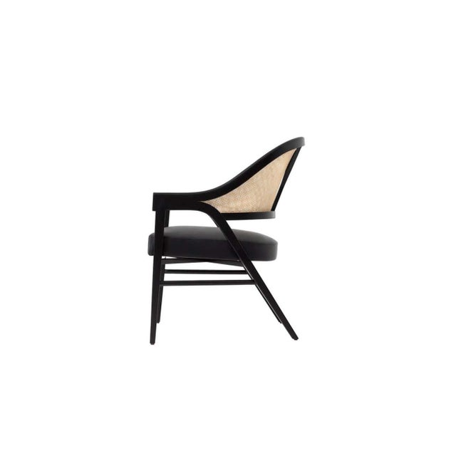 Contemporary timeless dining chair By Paulo Antunes. The seat is upholstered in high quality genuine black leather and the...