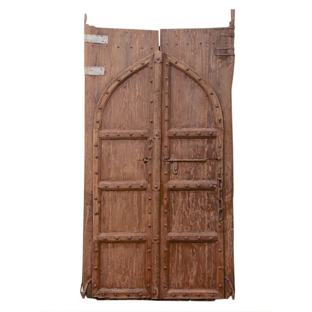 This antique Indian door was crafted using thick solid teak panels and  heavy, iron hardware. Mediterranean Pair of Antique Spanish Colonial Doors  ... - Pair Of Antique Spanish Colonial Doors Chairish