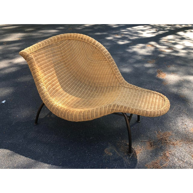 Stunning vintage wicker chaise lounge featuring biomorphic curves and organic sculptural design reminiscent of the Hans...