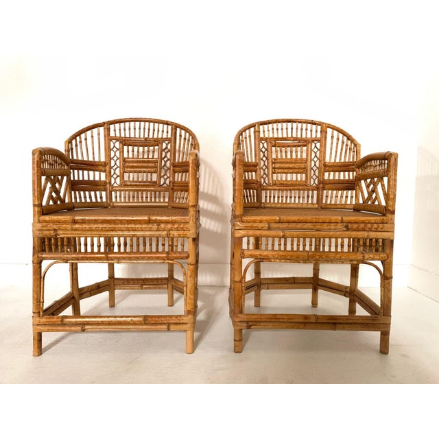 Pair of 1970s Bamboo Side Chairs. The seats are cane and the frame of the chairs have fret work pattern throughout.