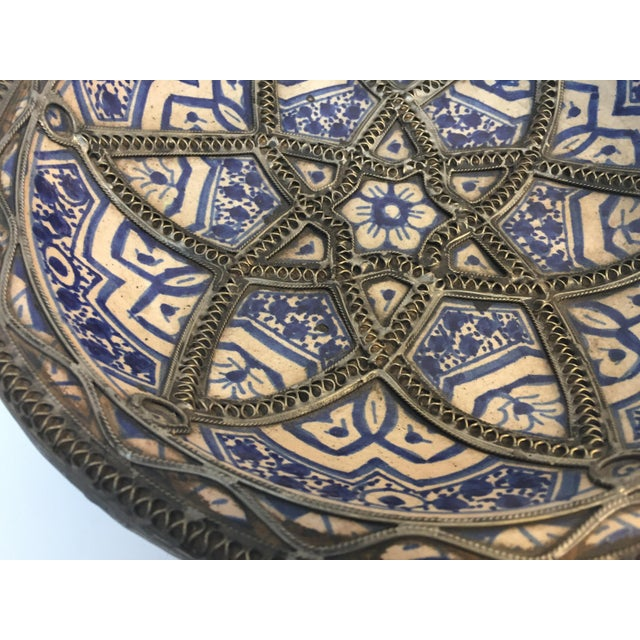 Handcrafted Moroccan blue and white decorative ceramic plate from Fez. Bleu de Fez, very nice designs hand painted by...